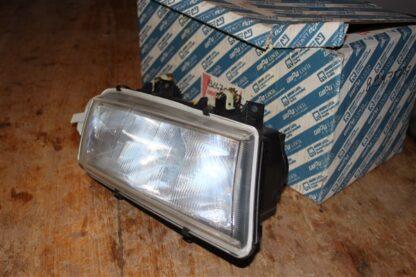 Lancia Delta koplamp linksvoor 82475332